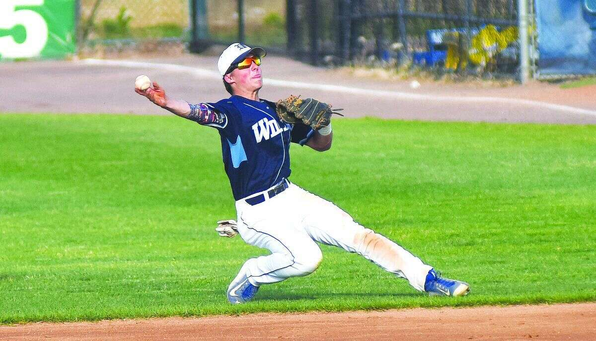 Hout photo/John Nash - Wilton second baseman Collin Kahal comes up firing to first after making a diving stop during Wednesday's FCIAC baseball semifinal against Darien at The Ballpark at Harbor Yard in Bridgeport.