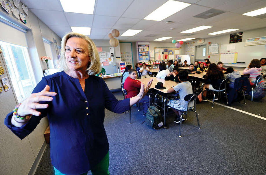 Jefferson Elementary School substitute teacher, Joanne Chariott, says students and teachers love the portable classrooms during an interview Wednesday, May 18, 2016, at the school in Norwalk, Conn. Jefferson has one of the most crowded schools and has 10 classrooms in portables. The over-enrollment of Norwalk public schools has led to the use of portable school classrooms at many schools.