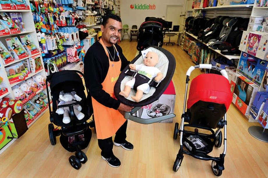 Hour photo / Erik Trautmann Tony Bermudez manager of Kiddie Hub at their new location on Wall St.
