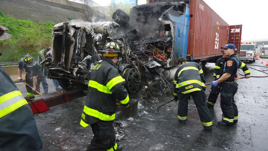 Contributed photoNorwalk Fire Department clears debris from I-95 after truck fire late morning on Thursday.