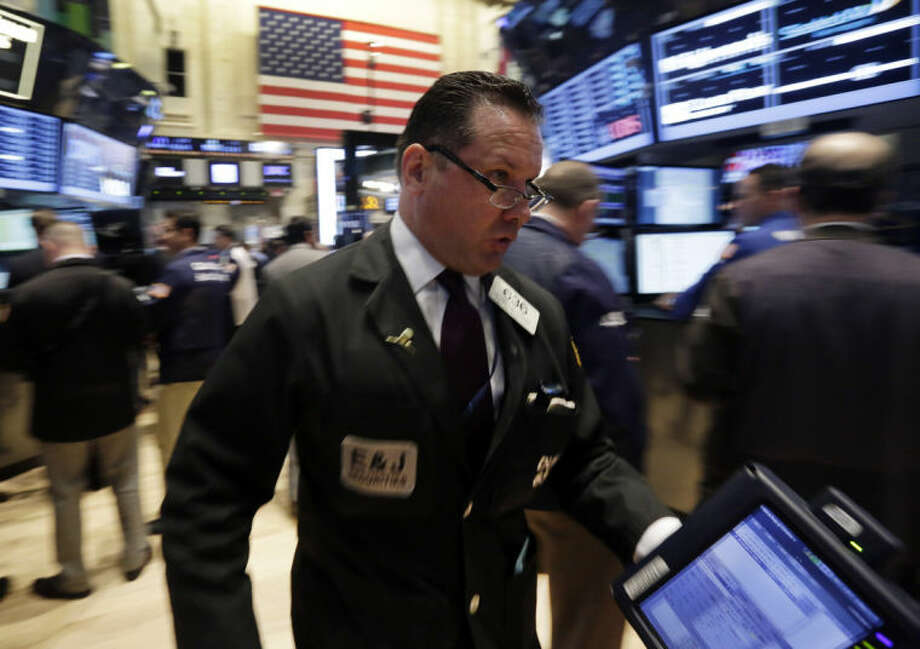 FILE - In this April 30, 2014 photo, trader Edward Curran rushes across the New York Stock Exchange floor. (AP Photo/Richard Drew, File)