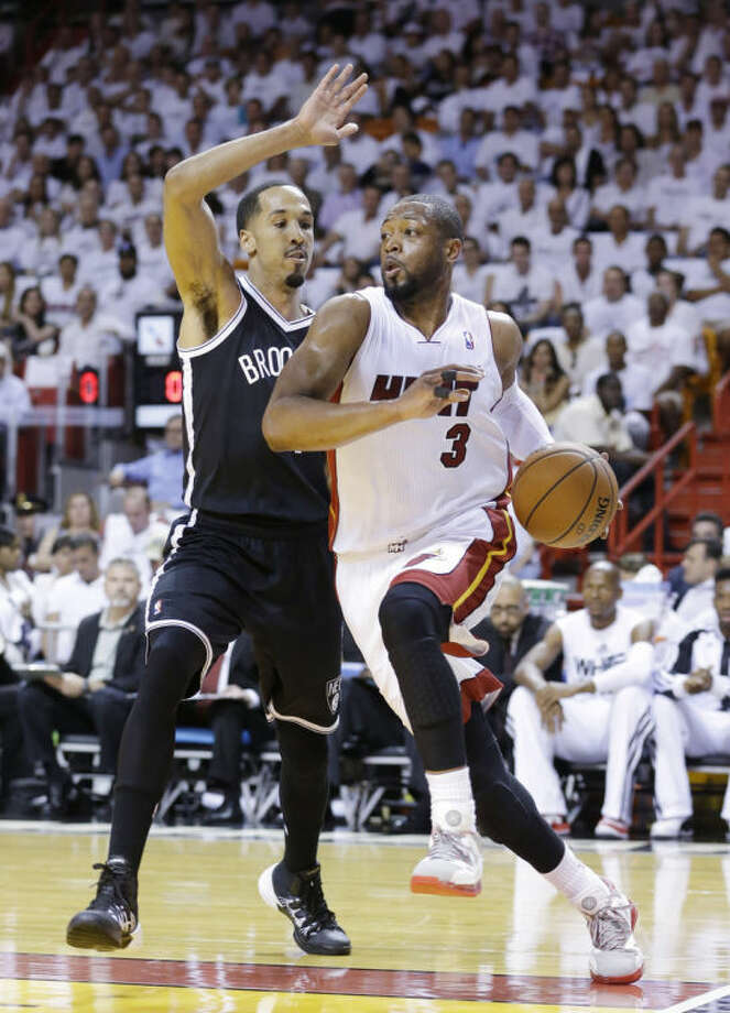 Miami Heat guard Dwyane Wade (3) drives gainst Brooklyn Nets guard Shaun Livingston during the first half of Game 2 of an Eastern Conference semifinal NBA playoff basketball game, Thursday, May 8, 2014 in Miami. (AP Photo/Wilfredo Lee)