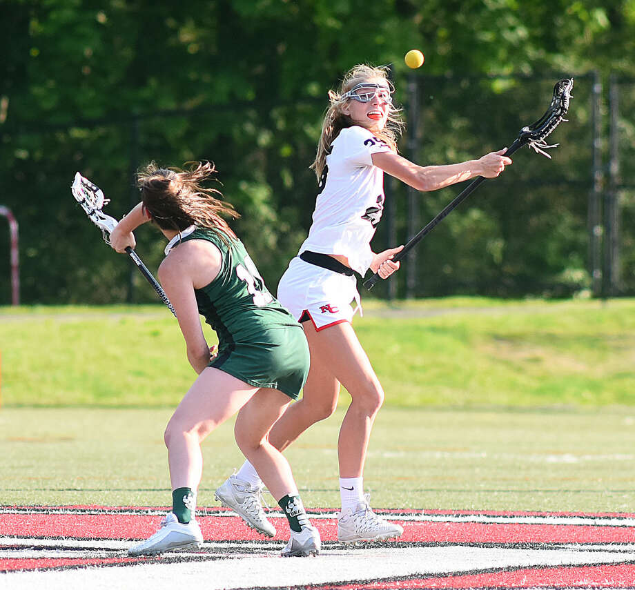 Action from Thursday's FCIAC girls lacrosse quarterfinal between Norwalk and New Canaan.