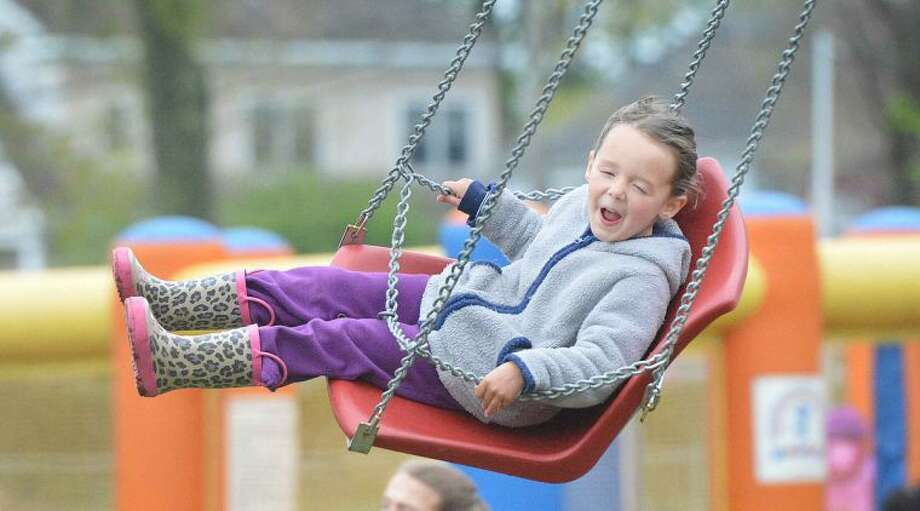 Hour Photo/Alex von Kleydorff 4yr old Lila Connor rides the swings at The Rowayton canival on Friday night