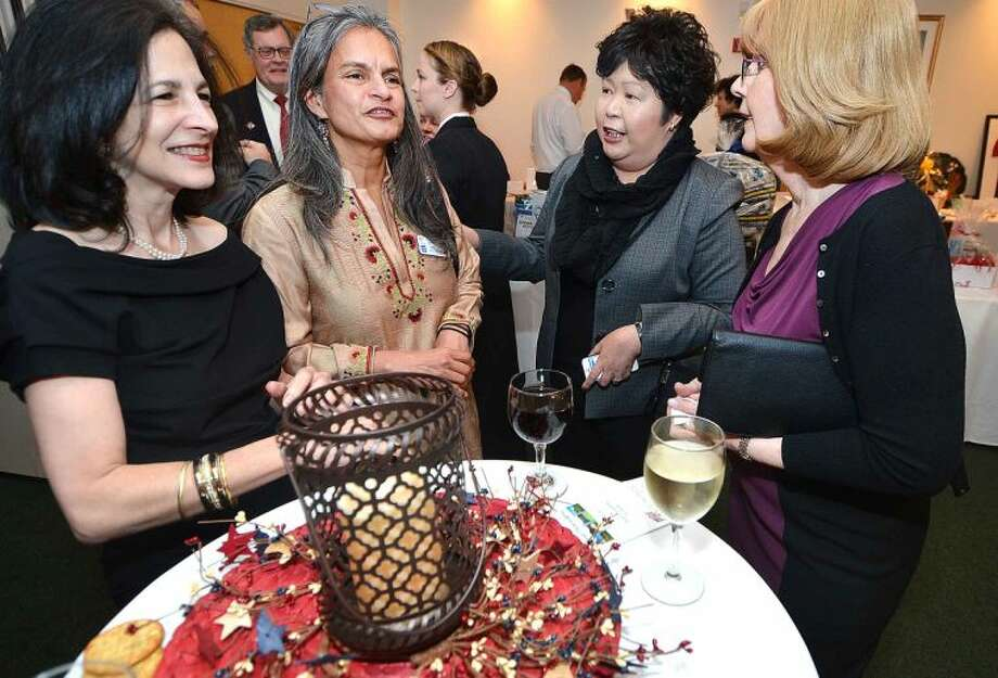 Hour Photo/Alex von Kleydorff State Rep Gail lavielle and Homes for The Brave Chairman Shalini Maderas talks with Irene Dixon and Donna Kingduring the reception at the ABRI/Homes for The Brave Salute 2014 Gala at the St Ann Club