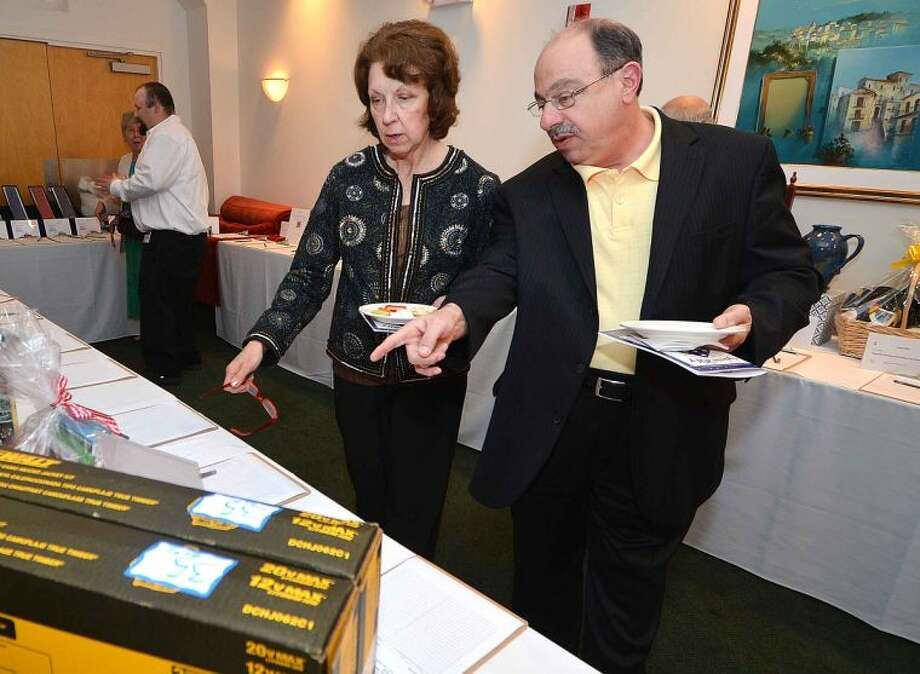 Hour Photo/Alex von Kleydorff Sal Spadaccino and wife Michelle bid on some of the silent auction items during the ABRI/Homes for The Brave Salute 2014 Gala at the St Ann Club