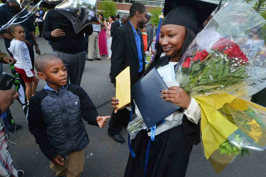 Jericha Robinson from Norwalk meets with family and friends after graduating with the class of 2016 at Norwalk Community College Commencement Exercises in Norwalk Conn. Thursday May 19 2016