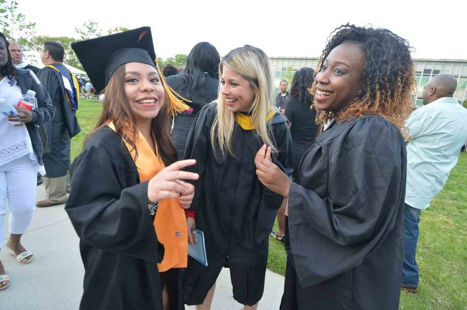 Estephania Aquilar from Norwalk talks with her success coaches after graduating with the class of 2016 at Norwalk Community College Commencement Exercises in Norwalk Conn. Thursday May 19 2016