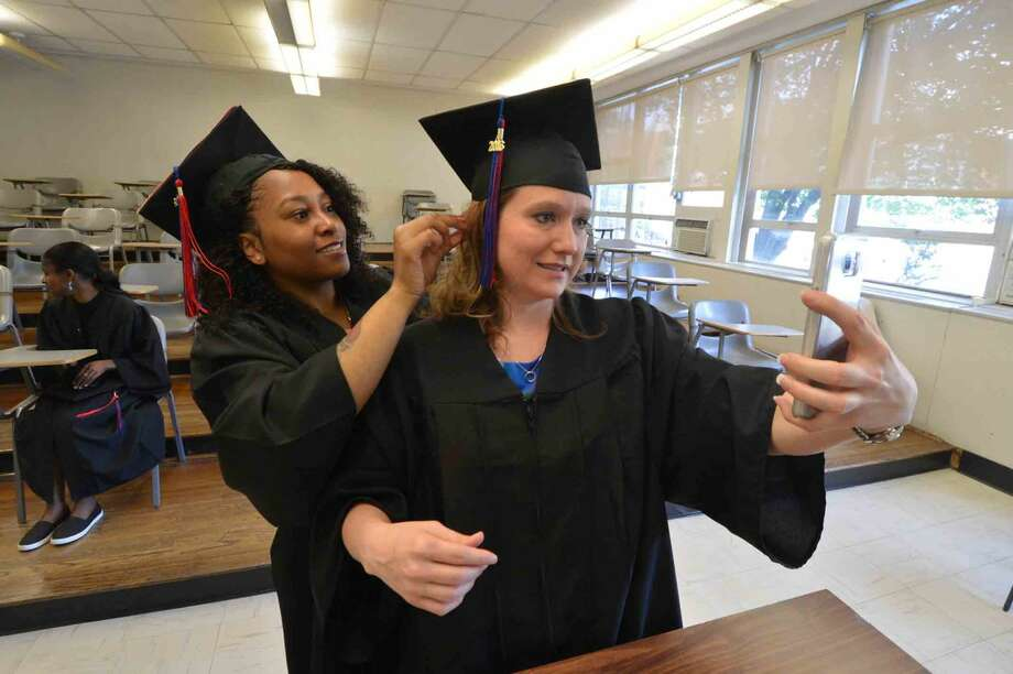 Norwalk's Bridgette Kasper and Mahogany Tillman take a moment before graduating with the class of 2016 at Norwalk Community College Commencement Exercises in Norwalk Conn. Thursday May 19 2016