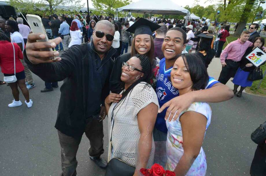 Norwalk's Simone Lewis grabs a photo with family after graduating with the class of 2016 at Norwalk Community College Commencement Exercises in Norwalk Conn. Thursday May 19 2016