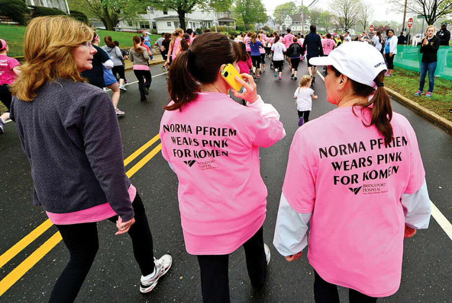 Hour photo / Erik Trautmann Particpants gather for the The Susan G. Komen Race for the Cure at Veterans Memorial Park Saturday.