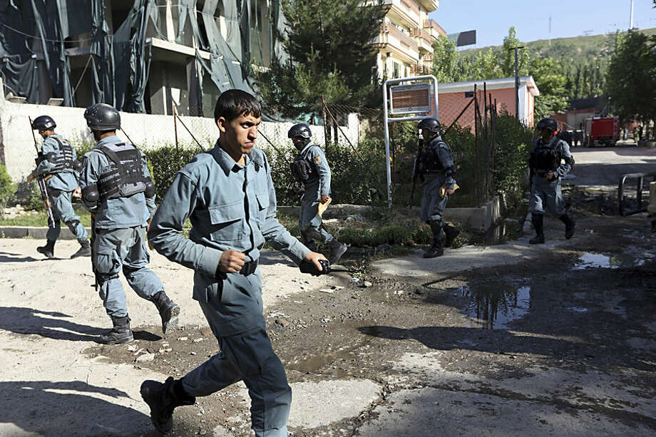 Afghan security officers patrol near a guesthouse targeted in an attack by the Taliban, in Kabul, Afghanistan, Wednesday, May 27, 2015. An all-night siege in an upscale neighborhood of Afghanistan's capital ended in the early hours of Wednesday morning with the deaths of four heavily armed Taliban attackers, though no civilians or security personnel were injured or killed, an Afghan official said. (AP Photo/Rahmat Gul)