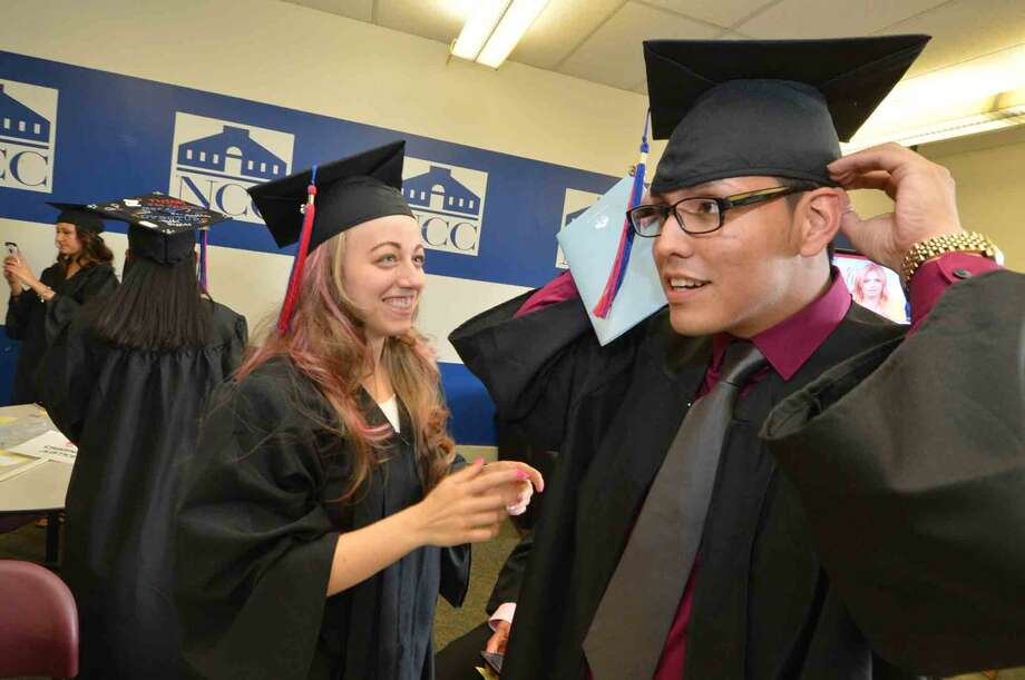 Alison Baker from Fairfield and Eric Barrero from Norwalk get their caps and gowns ready to graduate with the class of 2016 at Norwalk Community College Commencement Exercises in Norwalk Conn. Thursday May 19 2016