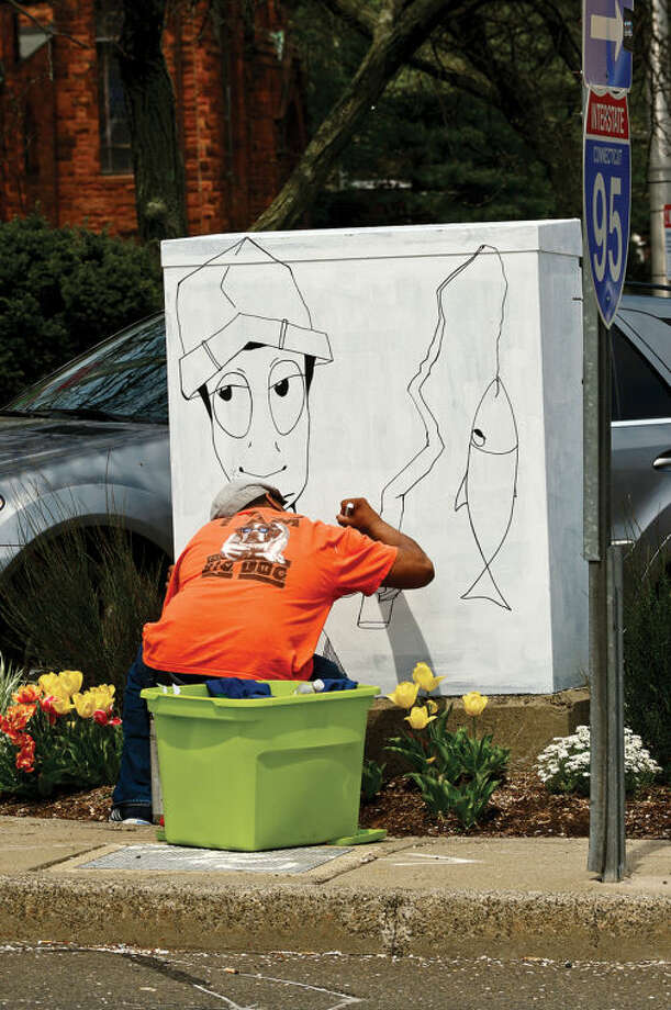 Hour photo / Erik Trautmann Norwalk artist Dooly-O paints a elctrical box along Martin Luther King BLVD as part of the Urban Art program which transforms traffic boxes along city streets in South Norwalk.