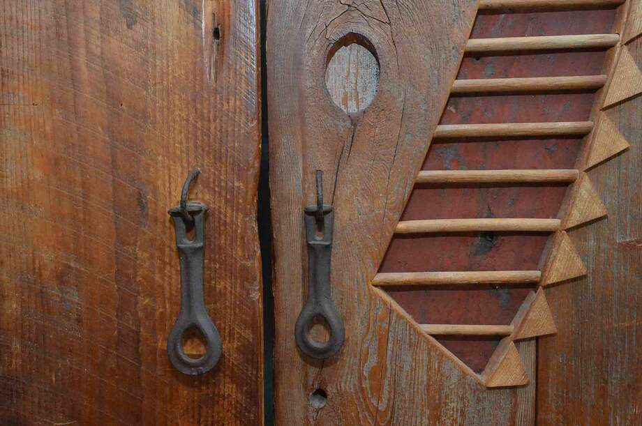 Detail of the handcratfted closet doors with wasboard inserts at 19 Jacob St. A former artists home and studio in Rowayton in Norwalk Conn. May 18 2016