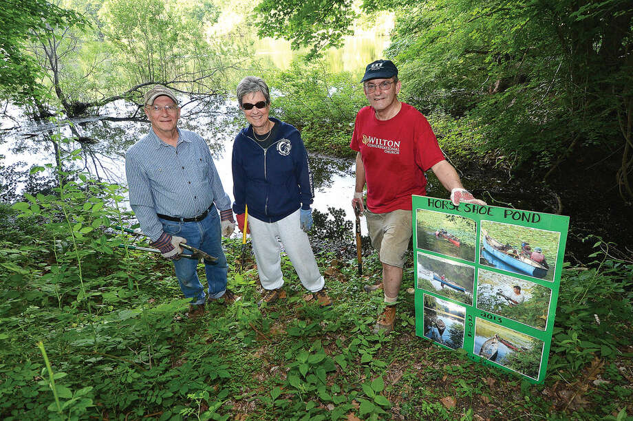 Frank Dunn, Anne Deware and Jerry Sprole are part of a group that plans to cleanup the property at Horseshoe Pond in Wilton.