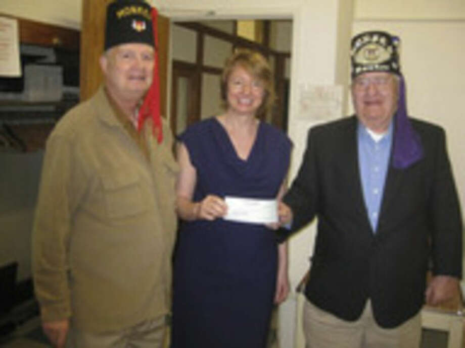 Contributed photoAt left, Dan Obuchowski presented Beatrix Winter of the Norwalk Senior Center with a check for $2,000.