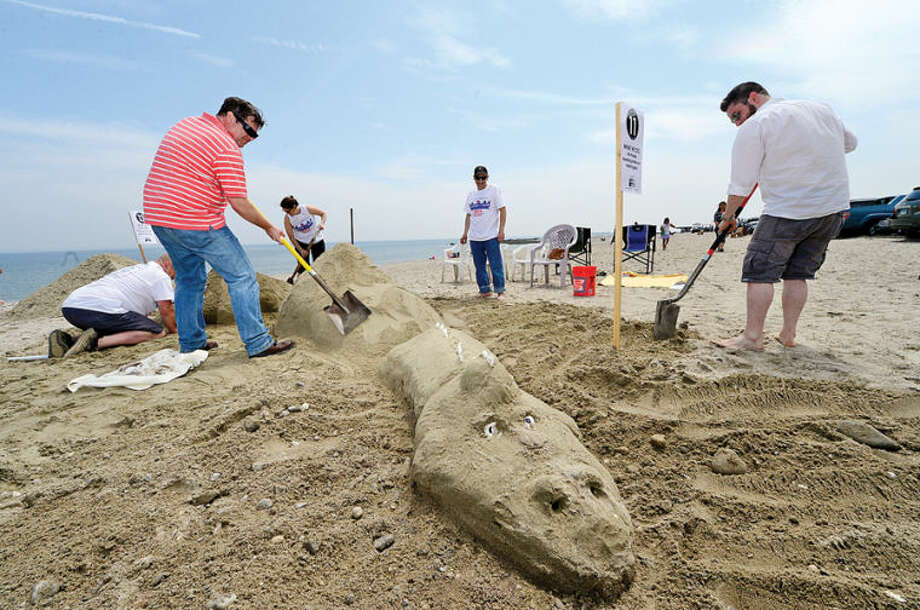 Hour photo / Erik Trautmann A team from the Gillespie Center participates in the Homes with Hope 13th annual Castles in the Sand sandcastle build-a-thon at Compo Beach in Westport on Saturday.