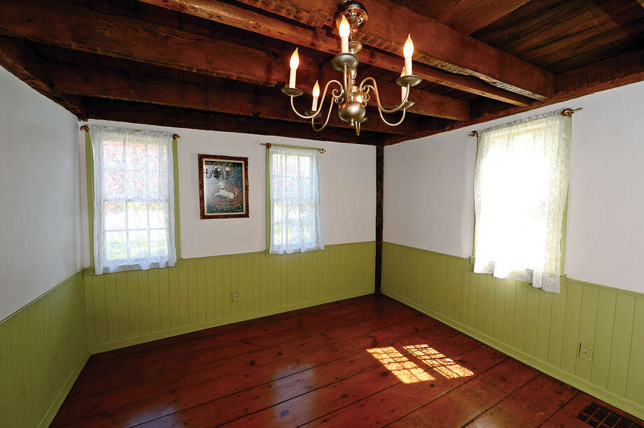 The home at 44 Adams Avenue in Norwalk, Conn on Tuesday, May 10, 2016 is for sale $399,000 and features some original flooring and hand-hewn beams. The Adams Avenue house is one of only a handful of homes to survive the Burning of Norwalk during the Revolutionary War.