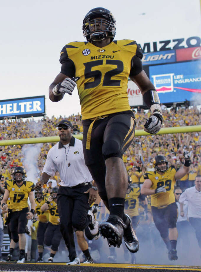 FILE - In this Sept. 8, 2012 file photo, Missouri's Michael Sam (52) runs onto the field along with their teammates before the start of an NCAA college football game against Georgia in Columbia, Mo. The NFL draft will conclude with Rounds 4 through 7 on Saturday, and when and if Sam is selected is sure to be the most significant development. The Southeastern Conference defensive player of the year last season for Missouri came out as gay in media interviews this year. (AP Photo/Jeff Roberson, File)
