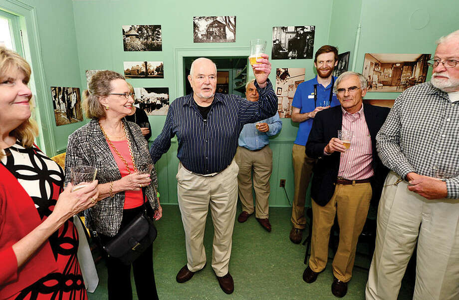 Hour photo / Erik Trautmann Charlie Burlingham, grandson of visionary American Impressionist Julian Alden Weir and President of the Weir Farm Art Center, makes a toast after donating his grandfather's works on behalf of the Weir Farm Art Center to Weir Farm National Park's permanent collection during a press conference Thursday.