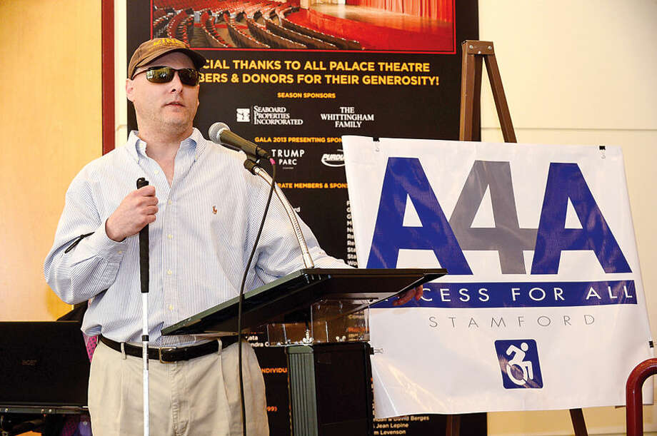 Blind Stamford resident, Phil Magalinick, speaks during a Stamford Access 4 All (A4A) press conference Wednesday at the Palace Theater.The mayor's committee on Access 4 All is a group of dedicated citizens and government representatives committed to improving access for all persons, regardless of ability, to Stamford's public programs, properties and services.