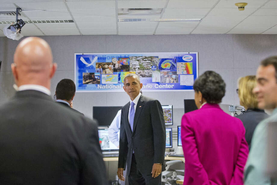 President Barack Obama tours the National Hurricane Center in Miami, Thursday, May 28, 2015, to draw attention to preparedness in advance of the annual storm season that formally begins June 1. (AP Photo/Pablo Martinez Monsivais)