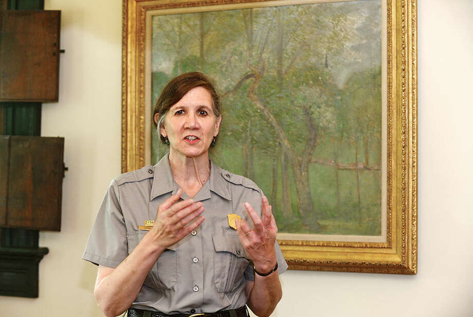 "Hour photo / Erik Trautmann Weir Farm National Park Superintendent Linda Cook speaks about the donated painting by visionary American Impressionist Julian Alden Weir, ""Landcape with Steeple, Windham"", during a press conference Thursday."