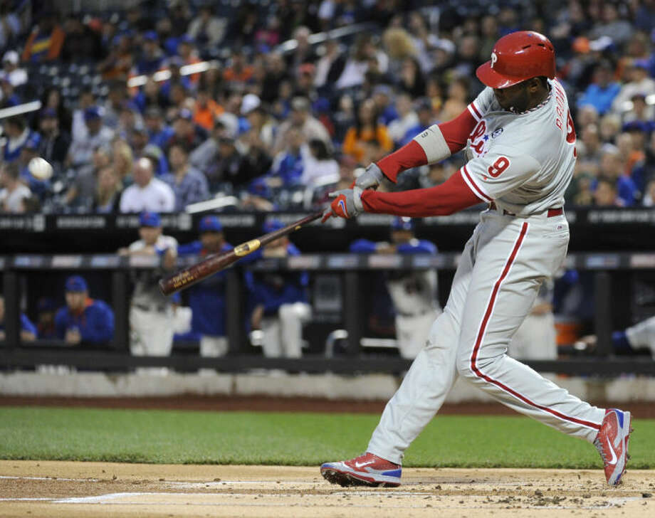 Philadelphia Phillies' Domonic Brown hits an RBI-single during the first inning of a baseball game against the Ne York Mets, Saturday, May 10, 2014, at Citi Field in New York. (AP Photo/Bill Kostroun)