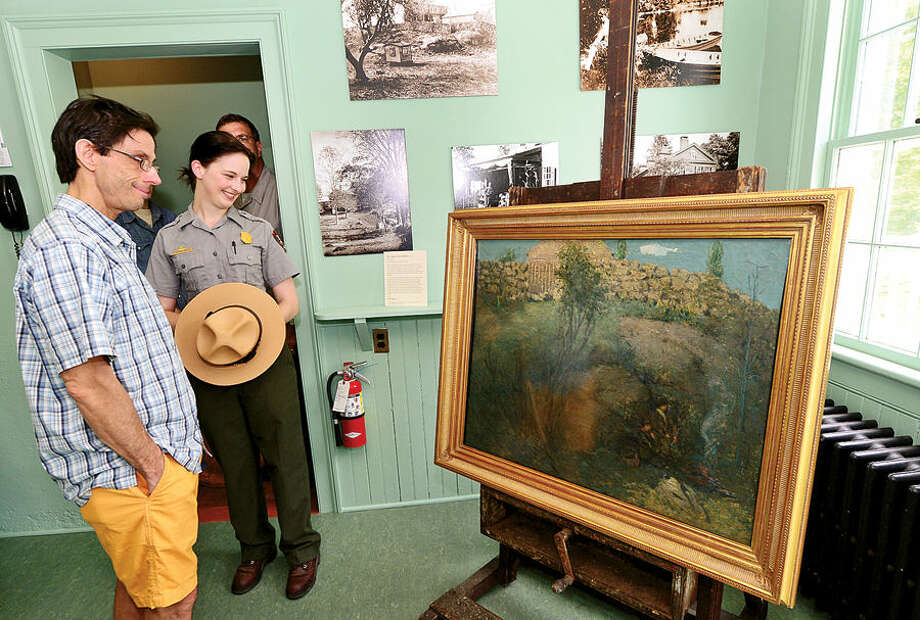 "Hour photo / Erik Trautmann Wilton resident Bob Monro and Weir Farm National Park staff Kathryn Hanley look over the Julian Alden Weir painting, ""The Truants"", after several of the artists original works were donated to Weir Farm's permanent collection during a press conference Thursday."