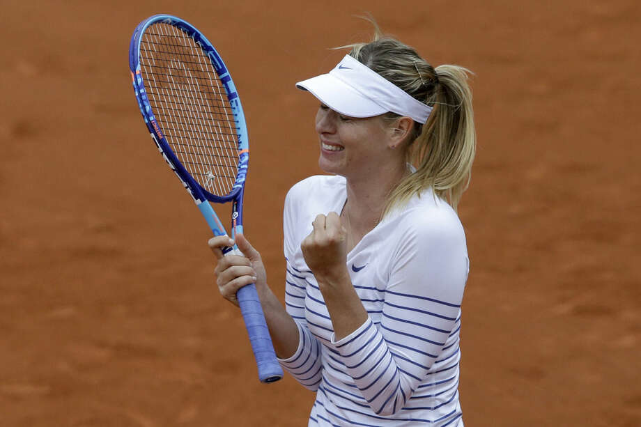 Russia's Maria Sharapova celebrates winning her third round match of the French Open tennis tournament against Australia's Samantha Stosur in two sets 6-3, 6-4, at the Roland Garros stadium, in Paris, France, Friday, May 29, 2015. (AP Photo/Thibault Camus)