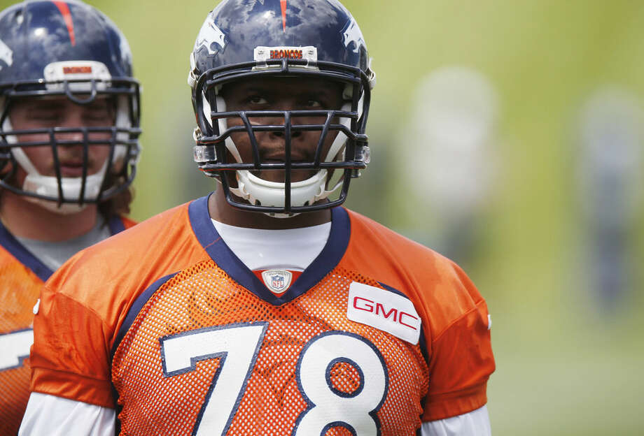 In this photo taken Wednesday, May 27, 2015, Denver Broncos offensive tackle Ryan Clady waits to take part in drills during an NFL football organized team activity at the team's headquarters in Englewood, Colo. Broncos officials announced Thursday, May 28, 2015, that Clady tore his left ACL while taking part in Wednesday's session, an injury that is likely to shelve the veteran offensive lineman for the season. (AP Photo/David Zalubowski)