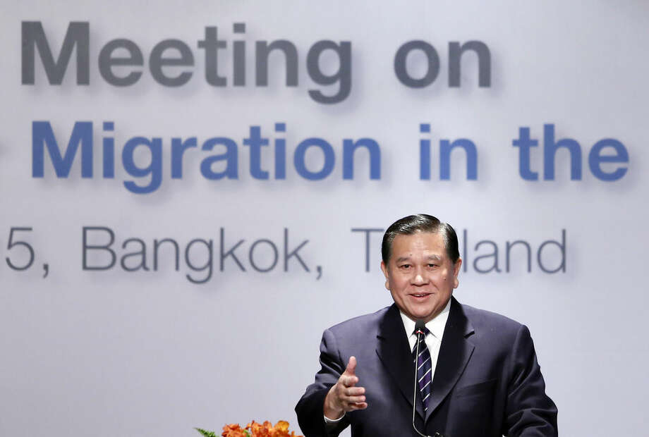 "Thai Foreign Minister Thanasak Patimaprakorn speaks at the ""Special Meeting on Irregular Migration in the Indian Ocean"" regarding the Rohingya and Bangladeshi migrant crisis at a hotel in Bangkok, Thailand, Friday, May 29, 2015. In the past month, more than 3,000 Rohingya Muslims fleeing persecution in Myanmar and impoverished Bangladeshis hoping to find jobs have landed on the shores of Indonesia, Malaysia and Thailand, drawing international attention to a crisis in Southeast Asia. (AP Photo/Charles Dharapak)"