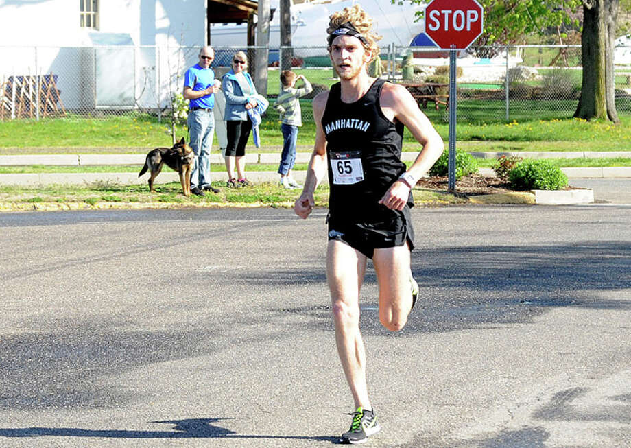 1st place Luke McCambley of Westport in 33 minutes at the annual Mothers Day 10 K race at Calf Pasture Beach. Hour photo/Matthew Vinci