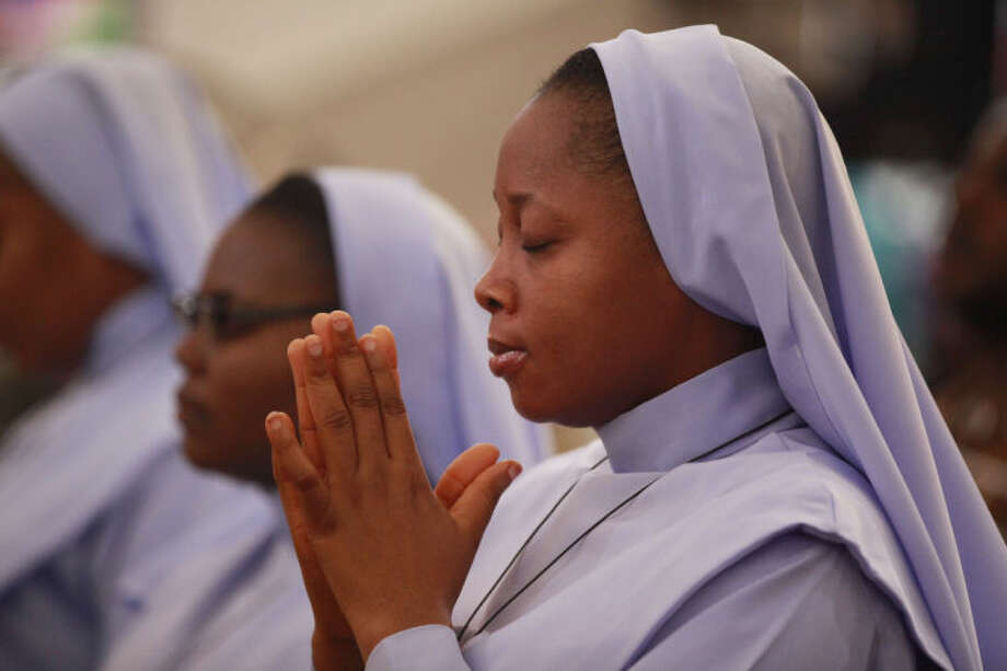 "Catholics Nuns attend a morning Mass given in honour of the kidnapped Chibok schoolgirls, in Abuja, Nigeria, Sunday May 11, 2014. The failure to rescue the kidnapped girl students who remain captive after some four weeks has attracted mounting national and international outrage, and one of the teenagers who escaped from the Islamic extremists who abducted the hundreds of schoolgirls, science student Sarah Lawan said Sunday in an interview with The Associated Press the kidnapping was ""too terrifying for words"". (AP Photo/Sunday Alamba)"