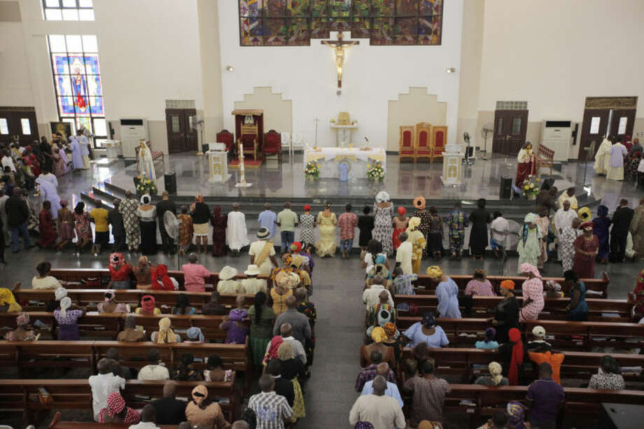 "Catholic faithful attend a morning Mass given in honour of the kidnapped Chibok schoolgirls, in Abuja, Nigeria, Sunday May 11, 2014. The failure to rescue the kidnapped girl students who remain captive after some four weeks has attracted mounting national and international outrage, and one of the teenagers who escaped from the Islamic extremists who abducted the hundreds of schoolgirls, science student Sarah Lawan said Sunday in an interview with The Associated Press the kidnapping was ""too terrifying for words"".(AP Photo/Sunday Alamba)"