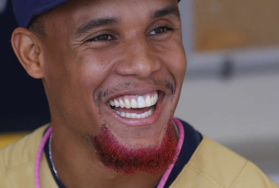 Milwaukee Brewers' Carlos Gomez sports a pink beard for Mother's Day before their game against the New York Yankees Sunday, May 11, 2014, in Milwaukee. (AP Photo/Jeffrey Phelps)