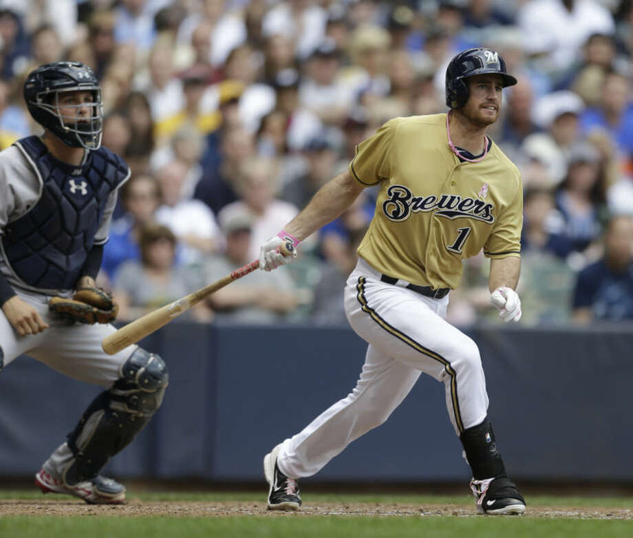 Milwaukee Brewers' Logan Schafer watches his run-scoring single against the New York Yankees during the sixth inning of a baseball game Sunday, May 11, 2014, in Milwaukee. (AP Photo/Jeffrey Phelps)