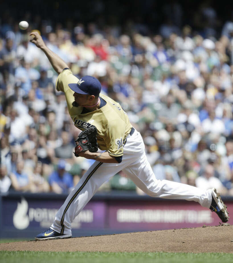 Milwaukee Brewers starting pitcher Matt Garza throws to the New York Yankees in the first inning of a baseball game Sunday, May 11, 2014, in Milwaukee. (AP Photo/Jeffrey Phelps)
