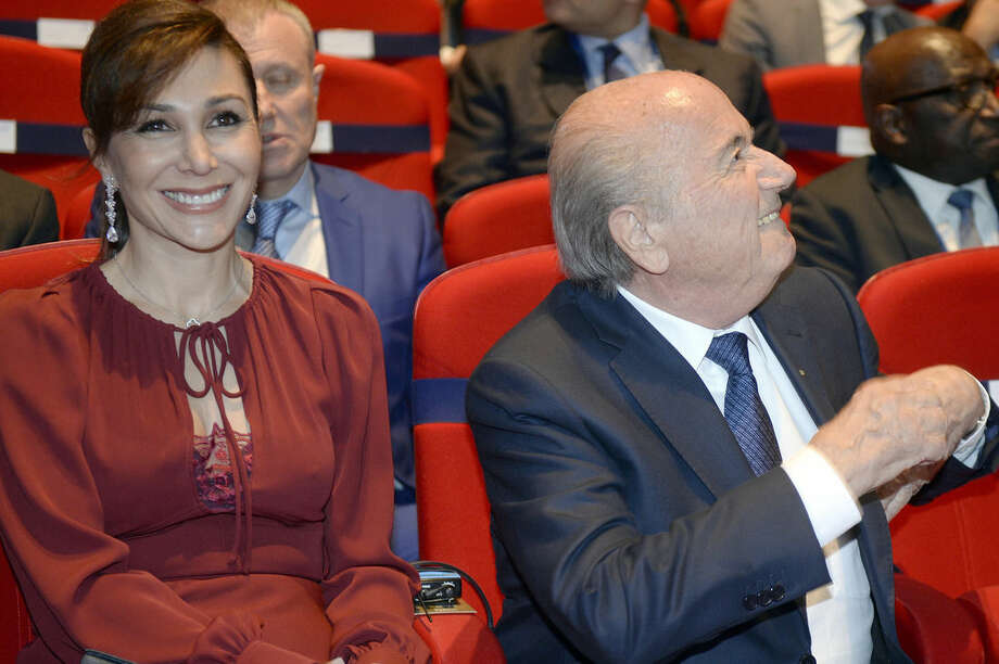 FIFA President Sepp Blatter, right, sits next to his girlfriend Linda Gabrielian, left, at the opening ceremony of the FIFA congress in Zuerich, Switzerland, Thursday, May 28, 2015. The FIFA congress with the president's election is scheduled for Friday, May 29, 2015 in Zurich. (Walter Bieri/Keystone via AP)