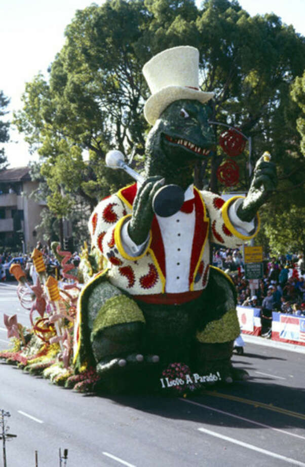 "This Jan. 1, 1991 photo provided by courtesy of the Tournament of Roses Association shows Godzilla on the Honda Float themed ""I Love A Parade,"" during the Rose Parade, in Pasadena, Calif. (AP Photo/Tournament of Roses Association)"