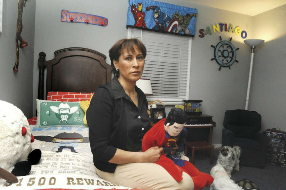 "Hour photo / Matthew VinciMaria ""GiGi"" Gonzalez in the room of her son Santiago, of whom she is currently fighting to regain custody in a legal battle that has spanned nearly two years."