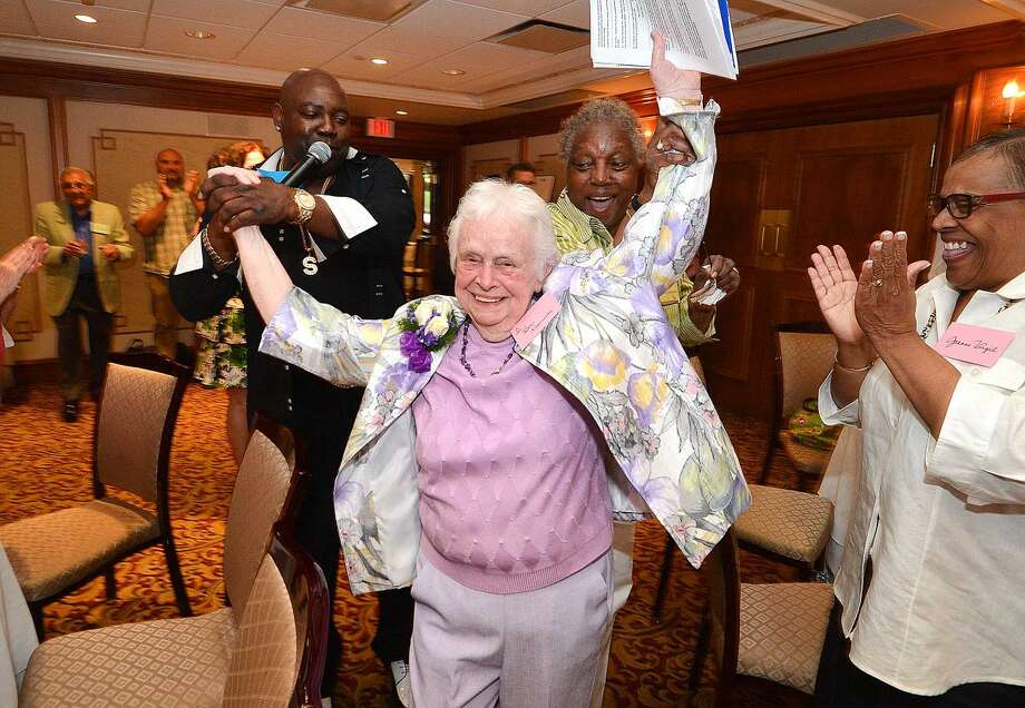 Hour Photo/Alex von Kleydorff Dr. Beatrice Krawiecki is led dancing into the ballroom for her retirement party after almost 60 years with the Norwalk Public School system