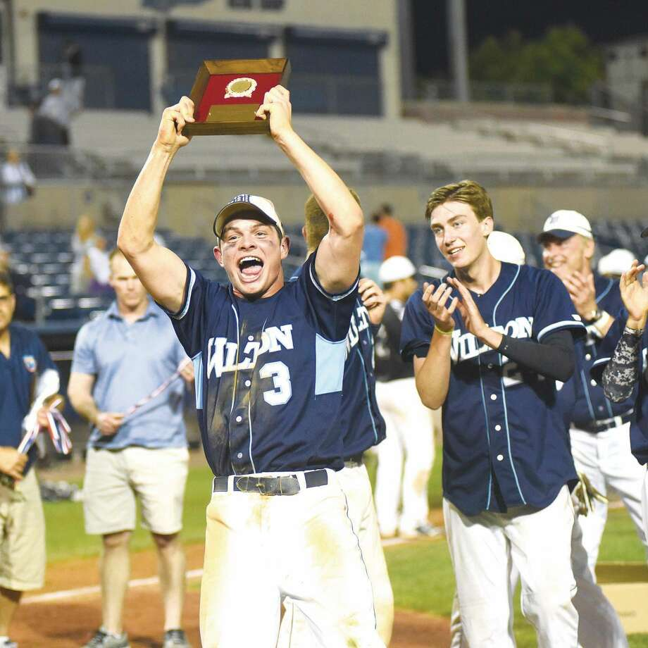 Hour photo/John Nash - Wilton seniors Jackson Ward, left, who had the game-winning hit, and winning pitcher JT Morin celebrate the Warriors FCIAC baseball championship on Friday night at The Ballpark at Harbor Yard.