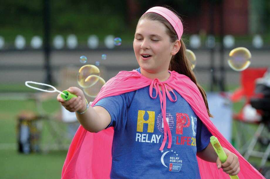 Hour Photo/Alex von Kleydorff. Kate Sreckovil with Cider Mill Schools Team Pink Ribbon brightens the day with bubbles at Wilton Relay for Life