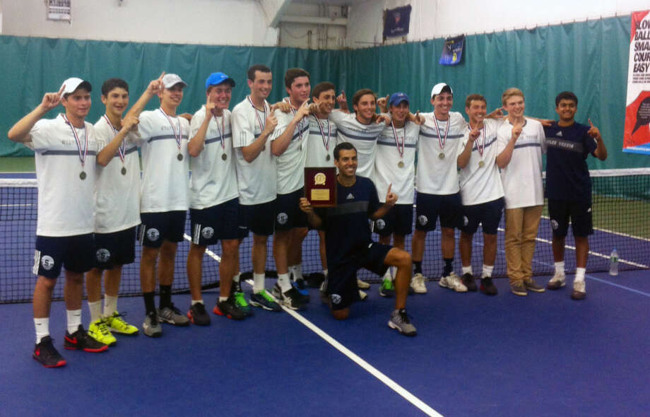 The Staples boys tennis team celebrates its second straight FCIAC title after defeating Greenich, 4-0 on Thursday. (Hour phot/Steve Geoghegan)