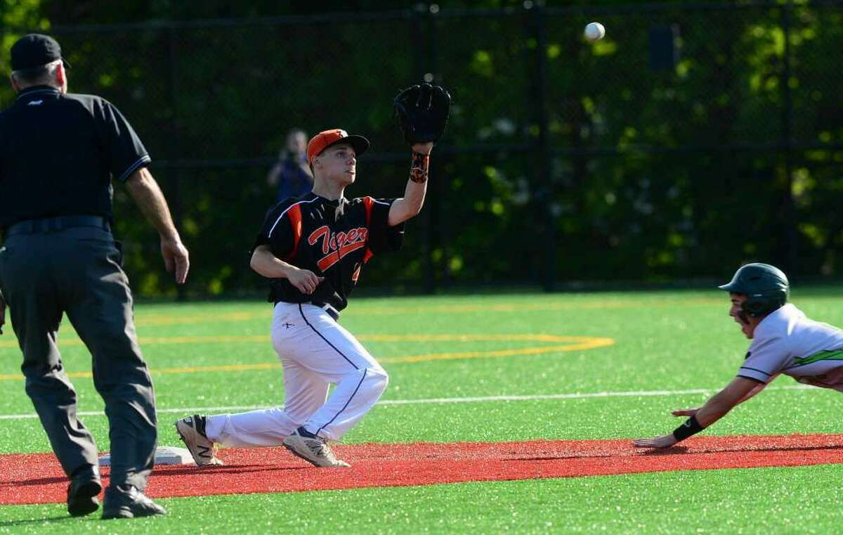 Ridgefield High School baseball team's shortstop Colin Motill waits for the thow before tagging Norwalk's Kyle Mossop in their FCIAC baseball quarterfinal game in Norwalk, Conn. Friday, May 20, 2016. (Photo: Erik Trautmann / Hearst Connecticut Media)