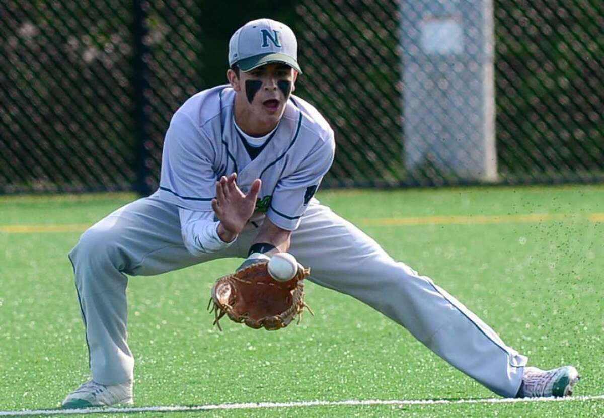 Norwalk High second baseman Kyle Mossop fields the ball Monday at Nathan Hale Middle School. Norwalk (12-9) beat Ridgefield and advanced to face top-seeded Darien in Monday's FCIAC semifinals at the Ballpark at Harbor Yard in Bridgeport. (Photo: EricTrautmann / Hearst Connecticut Media)