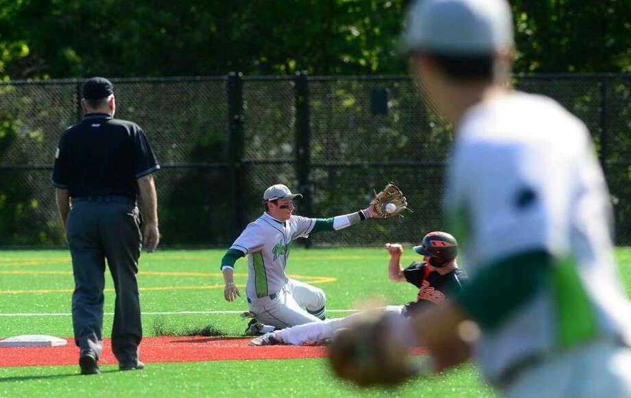 Norwalk High School baseball team's shortstop Eddie McCabe puts the tag on Ridgefield's #22 John Thrasher in their FCIAC baseball quarterfinal game in Norwalk, Conn. Friday, May 20, 2016. (Photo: Erik Trautmann / Hearst Connecticut Media)