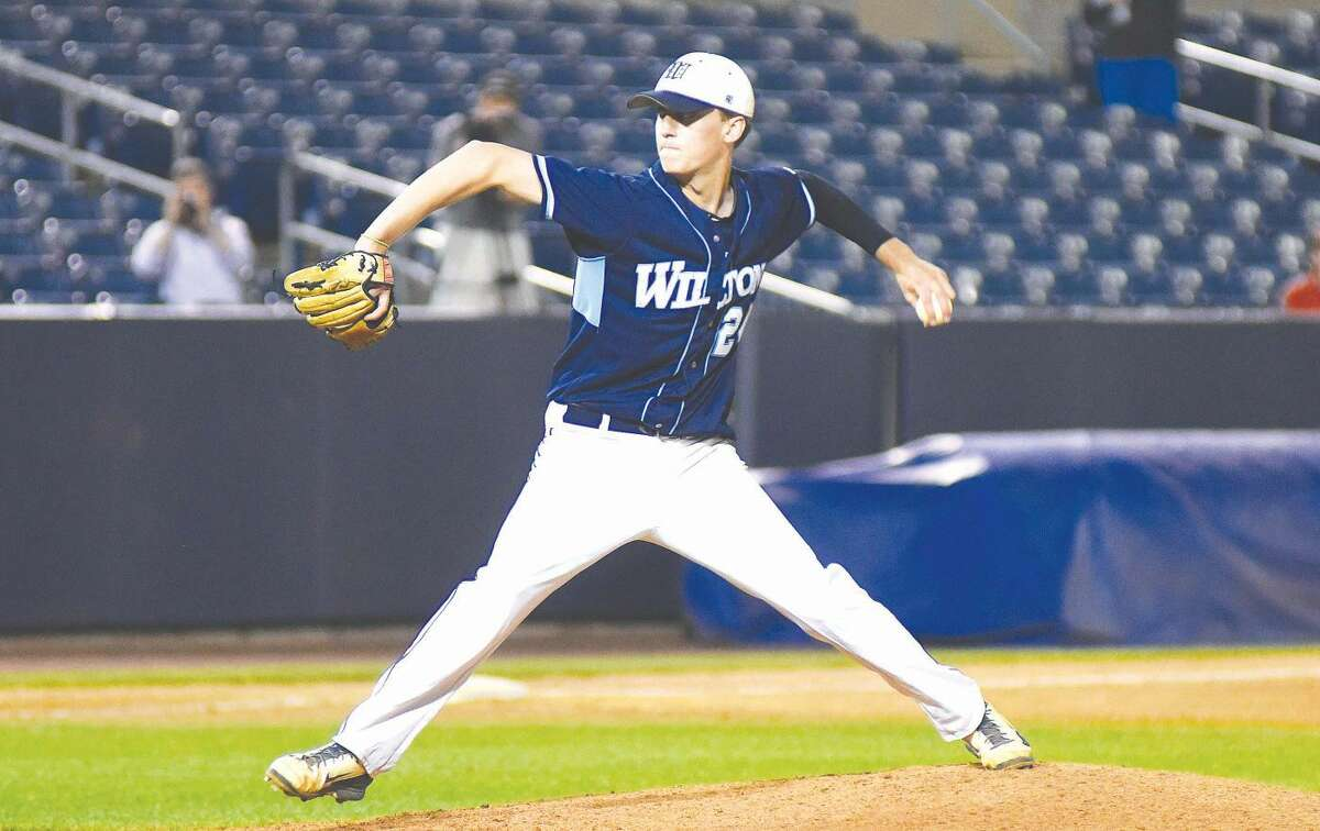 Hour photo/John Nash - Wilton pitcher JT Morin delivers the final pitch of the game, his 12th strikeout, as the Warriors defeated Staples 1-0 for the FCIAC championship at The Ballpark at Harbor Yard on Friday.